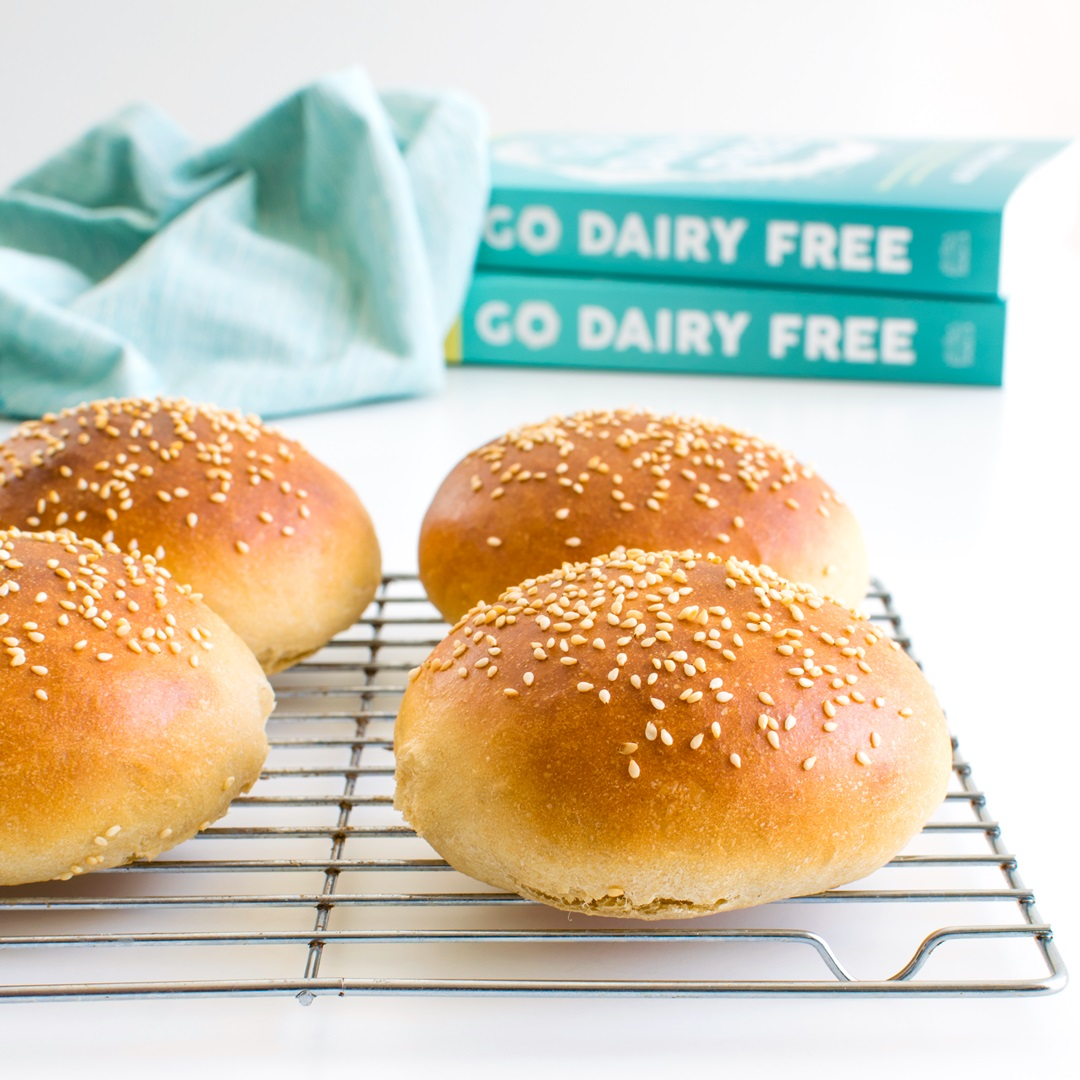 Speedy Homemade Wheat Hamburger Buns Recipe - fast and easy! Ready in just 40 minutes (no rise). Dairy-free with vegan option.