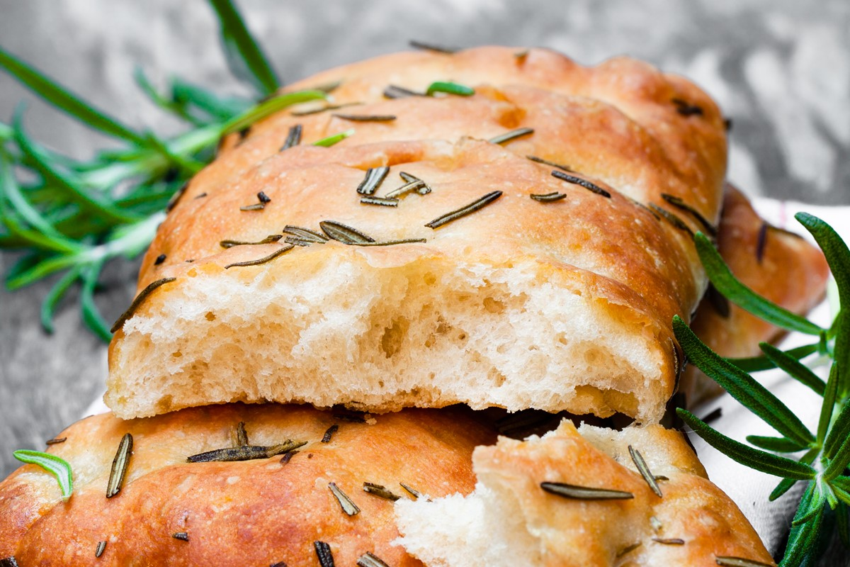 Vegan Focaccia Bread - a versatile, naturally dairy-free and cheese-free recipe. Topped with garlic and rosemary, but you can use different toppings.