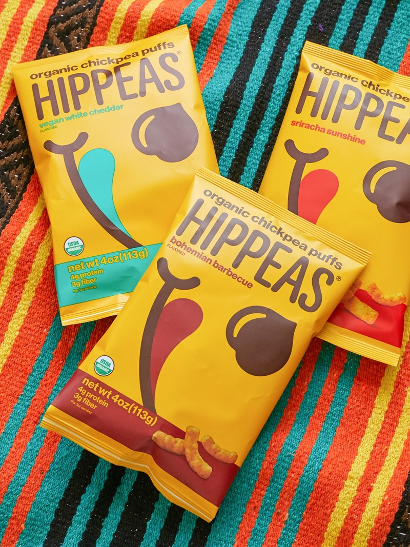 Hippeas Puffs Reviews and Info - Organic Chickpea Puffs in several dairy-free flavors, including cheesy vegan white cheddar and nacho vibes (also gluten-free and soy-free)