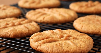 Freshly baked peanut butter cookies on cooling rack.  Macro with