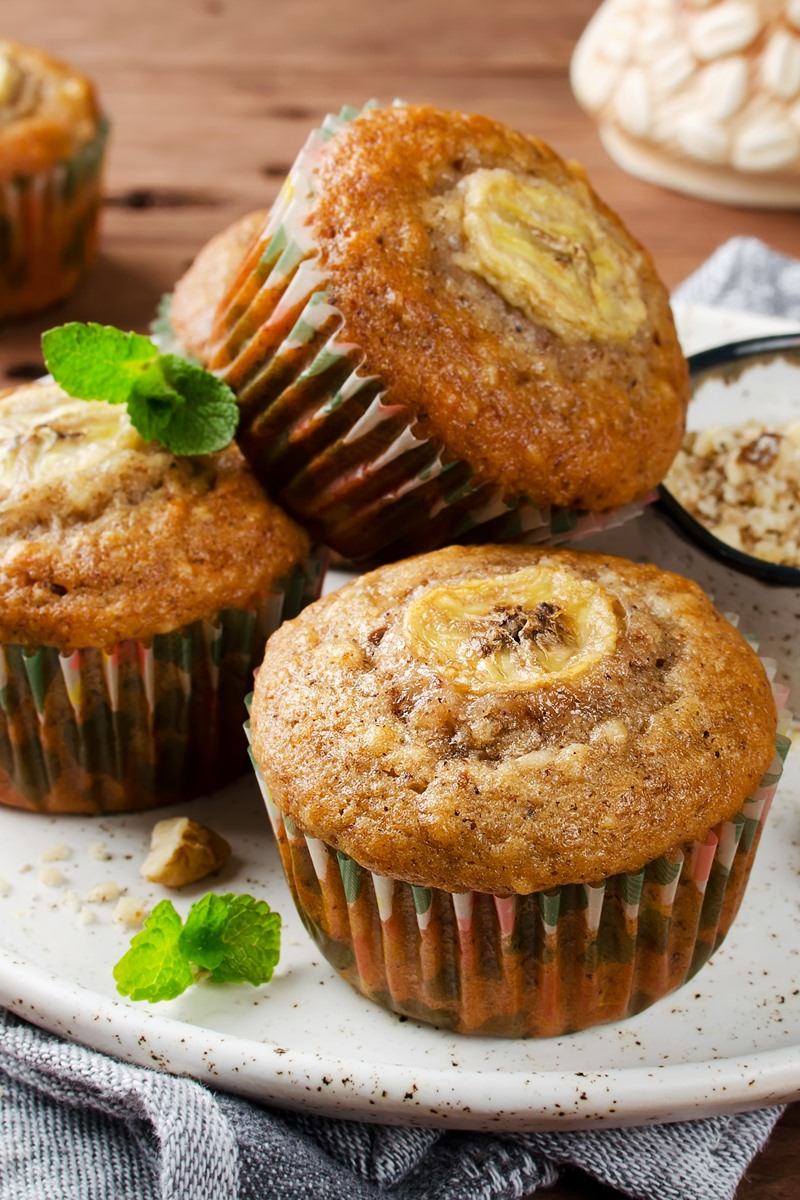 Whole Wheat Banana Muffins Recipe with Cinnamon and Raisins. Dairy-free, nut-free, and soy-free with gluten-free and vegan options.