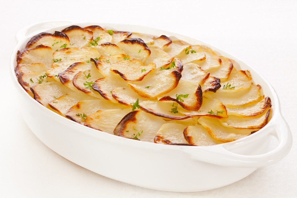 Dairy-Free Scalloped Potatoes Boulangère Recipe - No Butter and No Cheese! Vegan, gluten-free, and healthier than traditional scalloped potatoes or gratins.