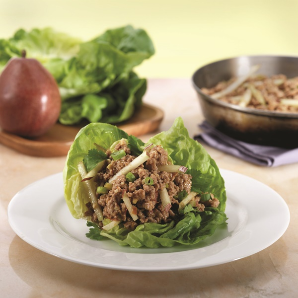 This Ellie Krieger recipe for Asian chicken lettuce wraps is a naturally dairy-free light meal (optionally gluten-free) that swaps water chestnuts with crunchy, sweet pears for a delicious seasonal twist!