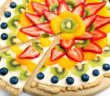 Fruit Tart Pizza Recipe with vegan sugar cookie crust and dairy-free cream cheese frosting