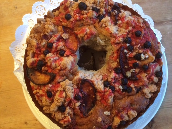 Peach-Berry Almond Coffee Cake with Cinnamon Crumb Topping - Filled with strawberries, and topped with peaches, blueberries and a sweet crumble, this delight is dairy-free, egg-free, and vegan!