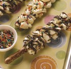 Nutty Popcorn Pretzel Sticks with Chocolate Drizzle