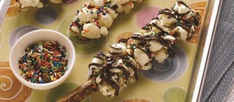 Nutty Popcorn Pretzel Sticks with Chocolate Drizzle