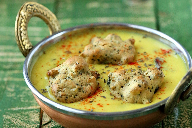 Baked Broccoli Dumplings in Indian-Spiced Yogurt Gravy (a healthier version of Pakore Waali Kadhi) the recipe is dairy-free, egg-free, gluten-free and vegan!