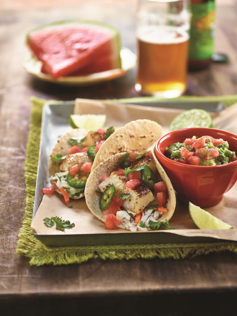 Baja Fish Tacos with Spicy Watermelon Guacamole - This naturally dairy-free and gluten-free dish (with paleo option) has amazing complimentary flavors (sweet, spicy, creamy, crunchy) and is perfect for al fresco entertaining.