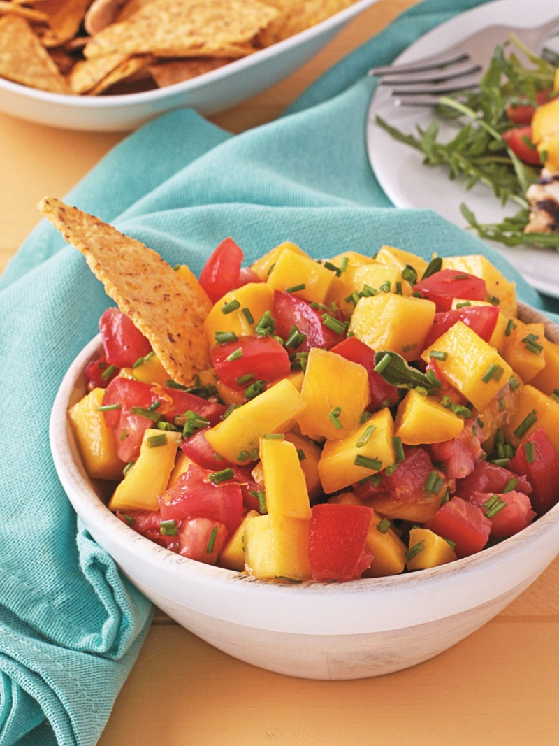 Zesty Mango Tomato Salsa Recipe- this mild but flavorful mix is perfect with chips, fish, chicken or tofu! Naturally dairy-free, gluten-free, vegan, paleo.