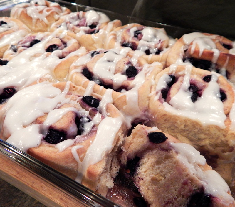 These tender, zesty blueberry breakfast buns are a tasty twist on traditional cinnamon rolls complete with lemony icing. Dairy-free recipe.