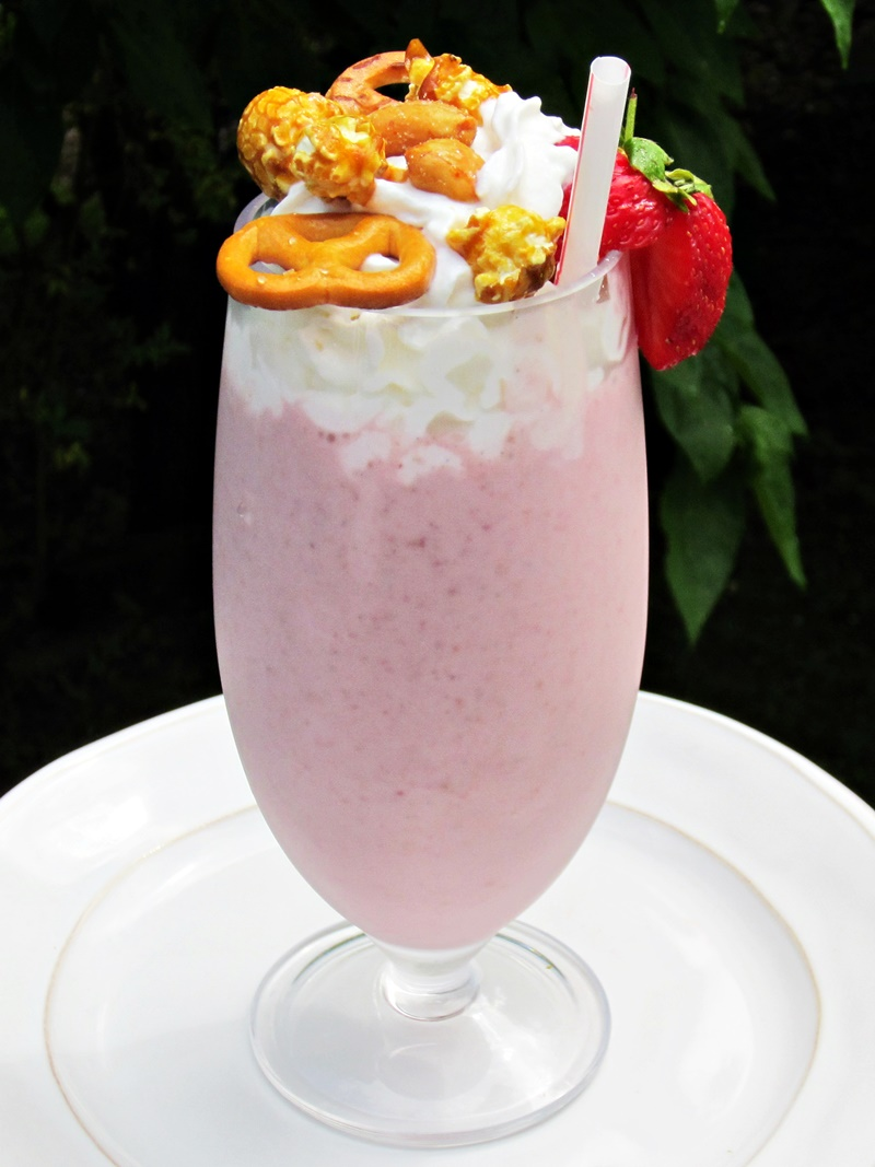 Enjoy the late baseball season and warm weather with this fun BallPark Strawberry Shake. It's a dairy-free and vegan creamy delight topped with peanuts and popcorn!