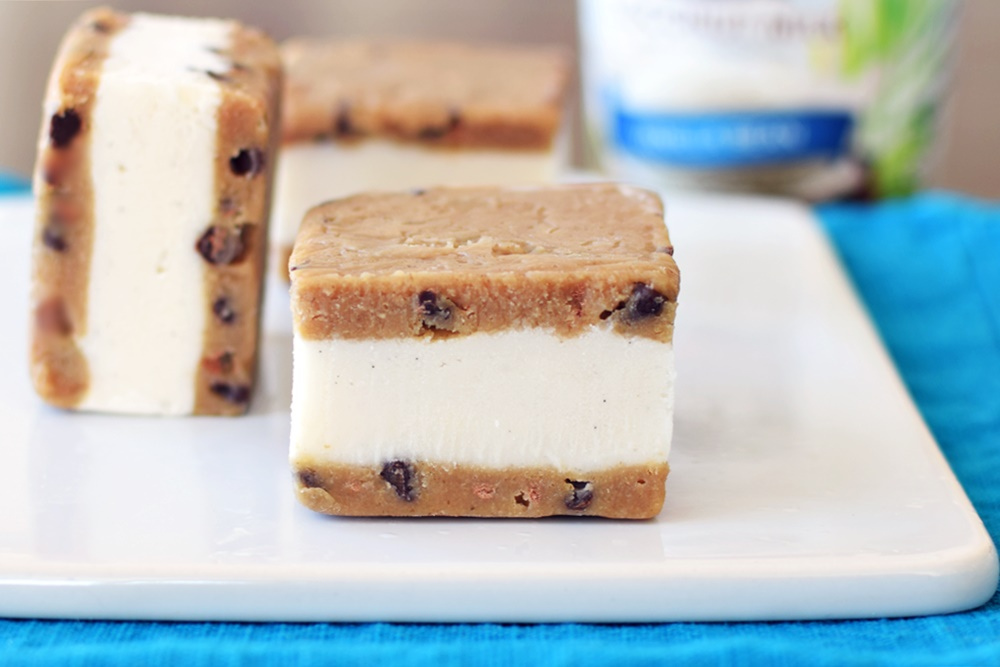 Cookie Dough Ice Cream Sandwiches - Dairy-Free Vanilla Bean Frozen Dessert sandwiched between Vegan Chocolate Chip Cookie Dough for over-the-top indulgence!