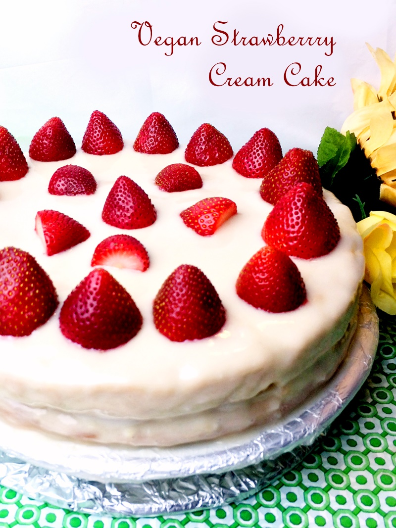 This luscious vegan strawberry cream cake is two layers of fluffy white cake with mild vanilla and coconut notes, adorned with a cream cheesy frosting and fresh strawberries. Dairy-free, egg-free, nut-free, and soy-free optional.