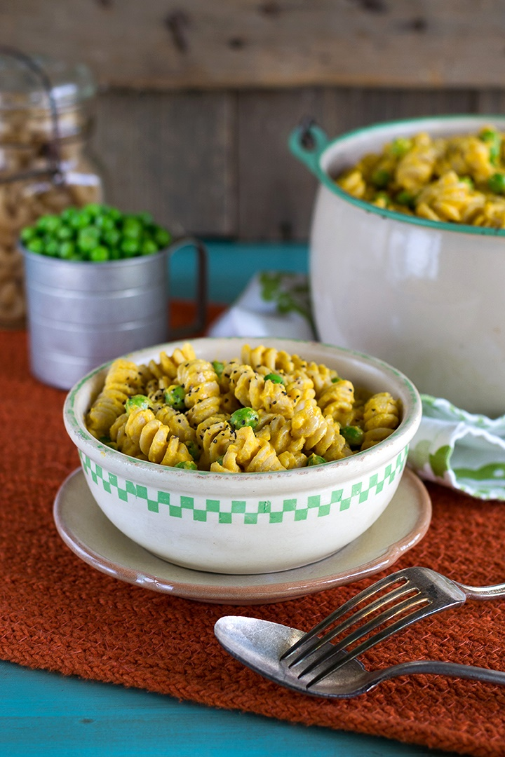 The rich sauce that completes this vegan mac 'n peas recipe is made mostly of butternut squash, but is enriched with cashews for a creamy finish, and spiked fresh garlic and flavorful, earthy spices to give it that comfort food flair. Gluten-free optional.