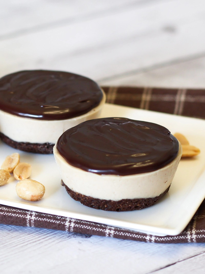 Vegan Peanut Butter Cup Pies Recipe - Chocolate gluten-free crust, rich cheesecake-like dairy-free filling, and a simple chocolate ganache! Can be made as a snack or sweeter for dessert!