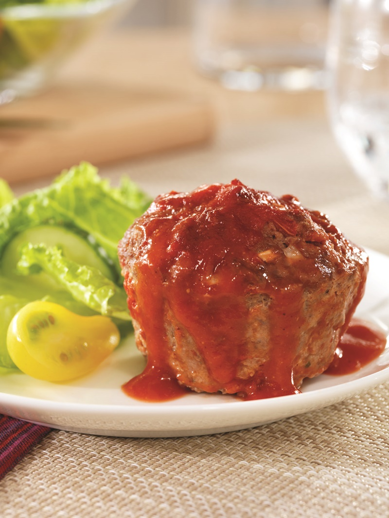 Even picky eaters will love (and help make!) these personal-size mini meatloaves with flavorful tomato sauce. Includes gluten-free and egg-free options.
