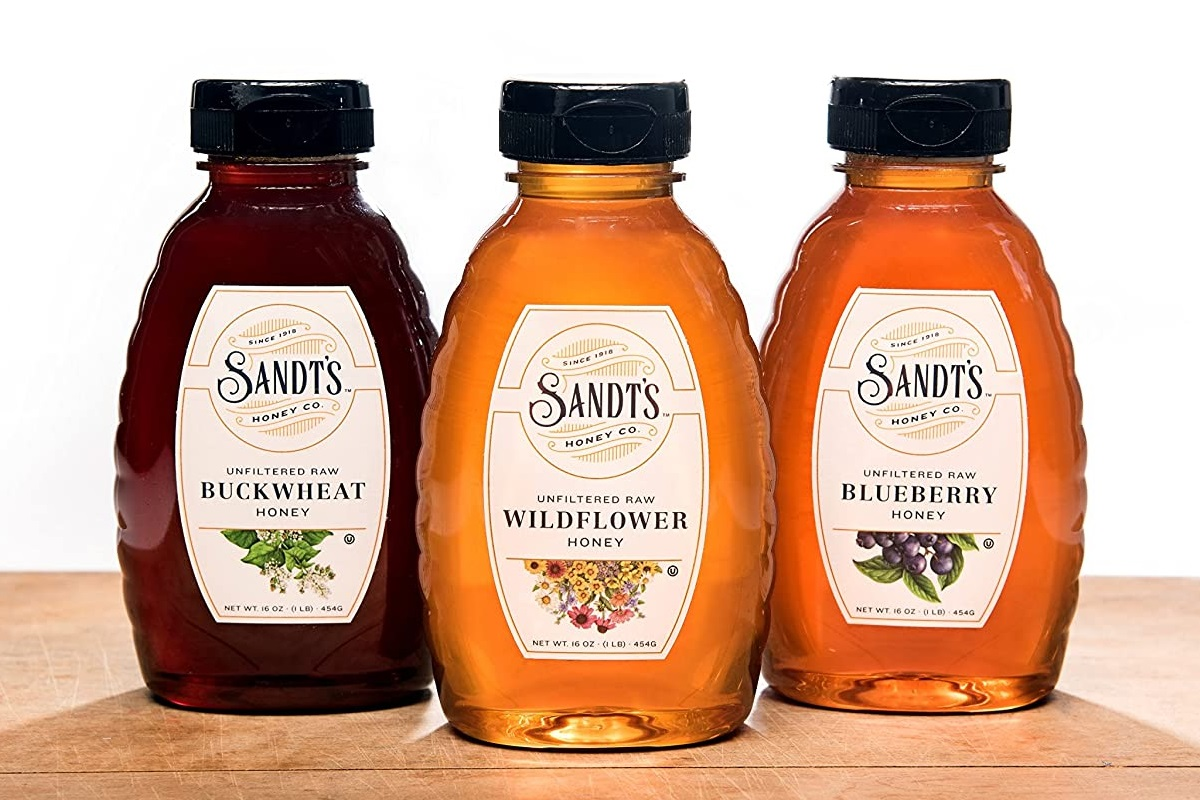 20 Delicious Dairy-Free Food Gifts for Everyone on Your List - unique presents with plant-based, vegan, gluten-free, paleo, and allergy-friendly options. Pictured: Sandt's Organic Raw Honey