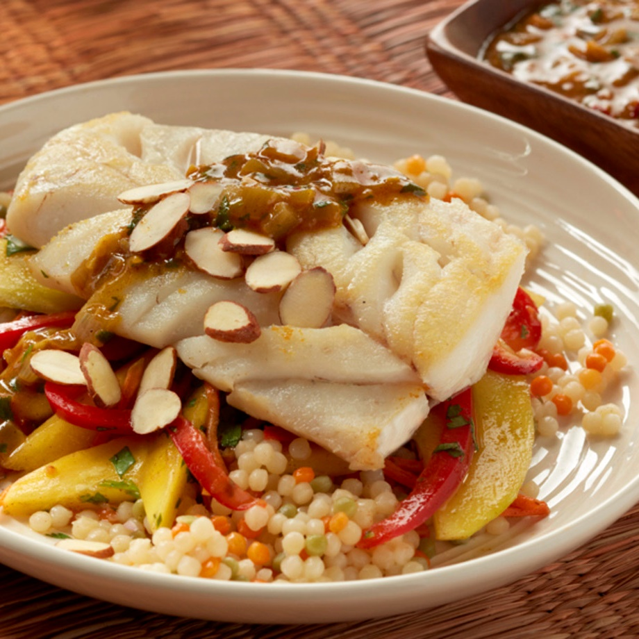 Moroccan-Style Cod over Couscous with Mango-Carrot Slaw. A naturally dairy-free recipe with gluten-free and paleo options.
