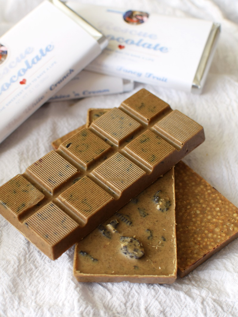 Rescue Chocolate Like White Chocolate Bars (Review) - vegan, dairy-free, nutty rich goodness in taste and virtue (profits donated to animal rescue). Amazing flavors: Cookies & Cream, Fancy Fruit & Crunch