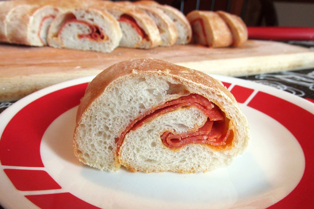 """Dairy-Free Pepperoni Rolls Recipe - the pepperoni provides richness and """"cheesy"""" flavor to the bread. Includes a vegan option."""