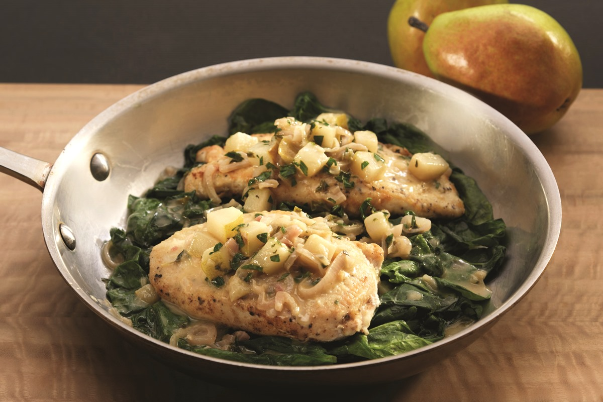 Crispy Chicken Cutlets with Shallot-Pear Sauce over Wilted Spinach