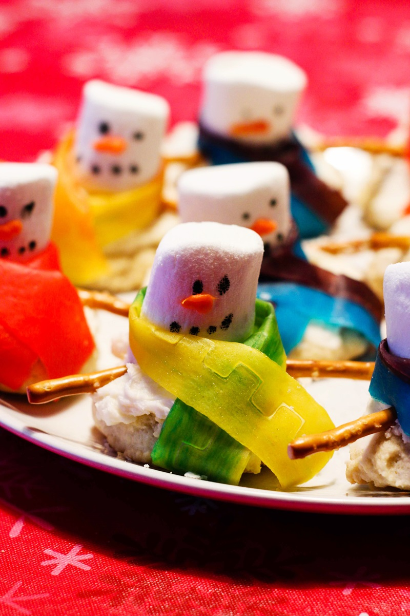 Dairy-free Melting Snowman Cookies Recipe - with homemade vegan vanilla icing and the decorations. Also nut-free & optionally soy-free.