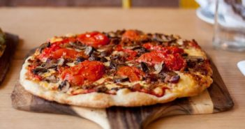 Hugo's Pizzeria in St. Louis, MO offers dairy-free cheese and gluten-free crust for no extra charge. Plus vegan meat options.