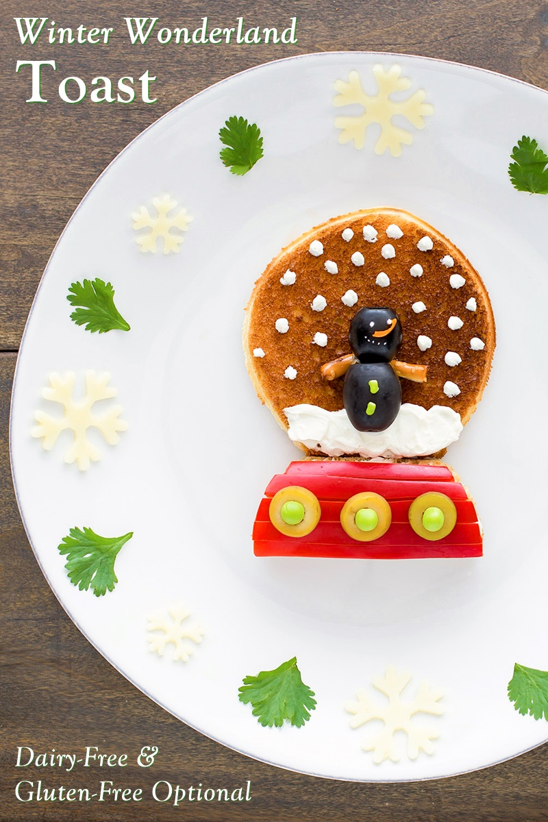 Winter Wonderland Olive Toast Recipe - a fun, easy snow globe scene! It's also dairy-free, vegan, nut-free, and optionally gluten-free