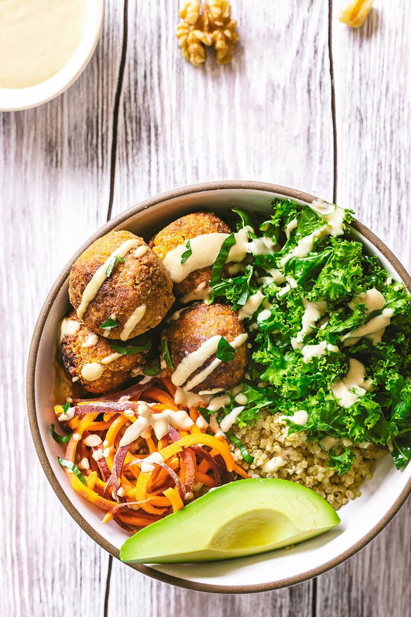 Sweet Potato Falafel Bowls Recipe with Quinoa, Kale, and Tahini Dressing - plant-based and dairy-free with vegan option.
