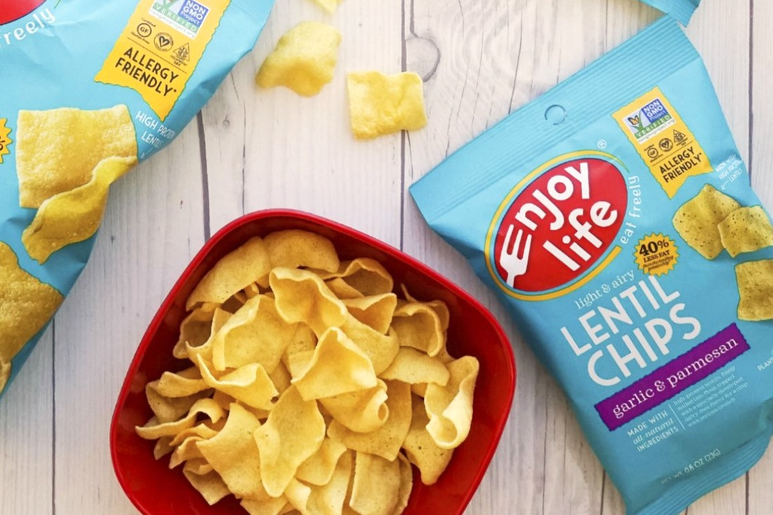The Best Crunchy Cheesy Dairy-Free Snacks - from crackers to chips, puffs to popcorn, and more! Vegan, Gluten-Free, and Grain-Free Options. Pictured: Enjoy Life Parmesan Lentil Chips