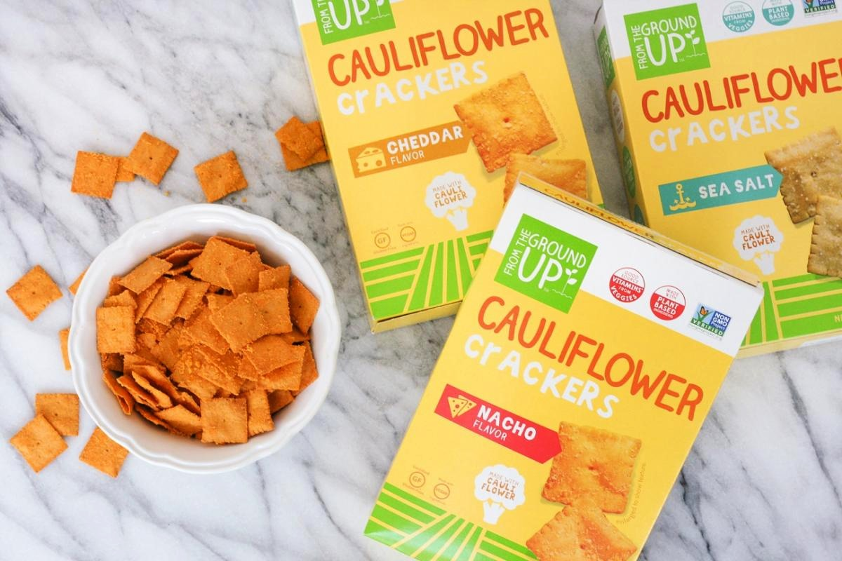 The Best Crunchy Cheesy Dairy-Free Snacks - from crackers to chips, puffs to popcorn, and more! Pictured: From the Ground Up Cauliflower Nacho and Cheddar Crackers