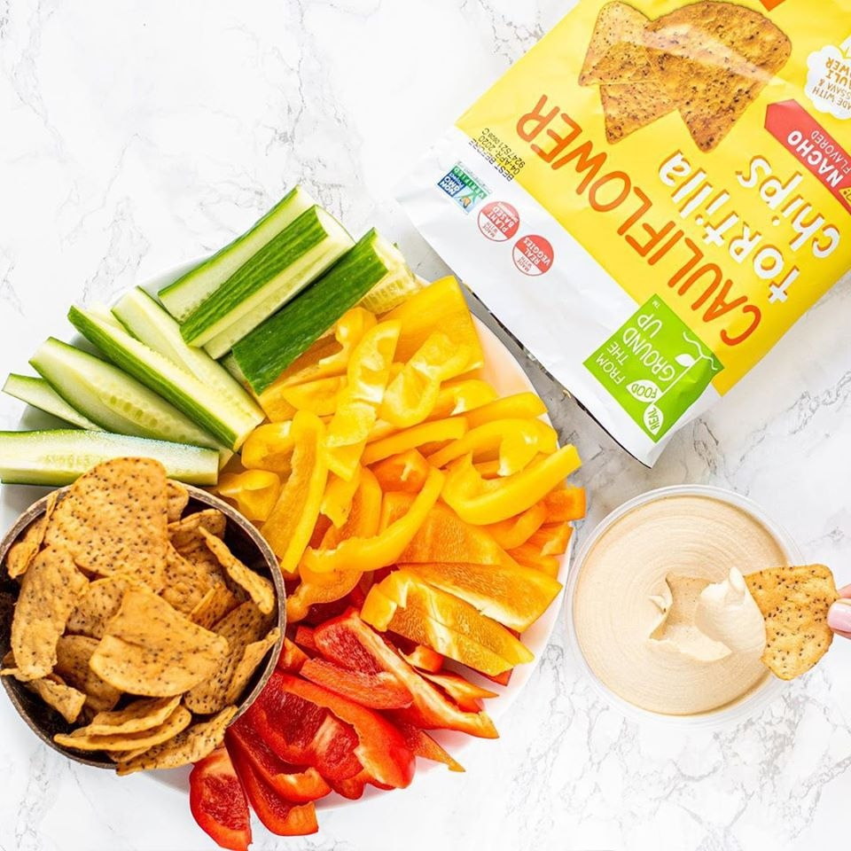 The Best Crunchy Cheesy Dairy-Free Snacks - from crackers to chips, puffs to popcorn, and more! Pictured: From the Ground Up Cauliflower Nacho Tortilla Chips