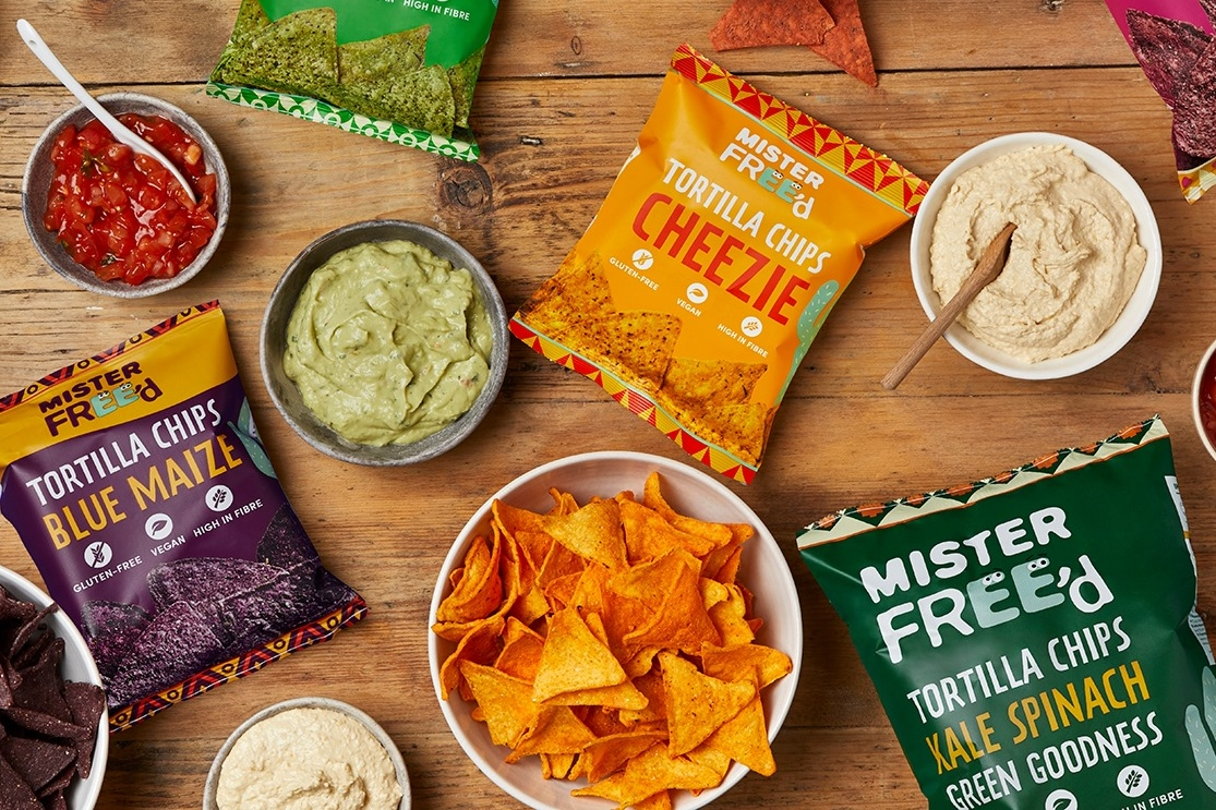 The Best Crunchy Cheesy Dairy-Free Snacks - from crackers to chips, puffs to popcorn, and more! Vegan, Gluten-Free, and Grain-Free Options. Pictured: Mister Free'd Tortilla Chips