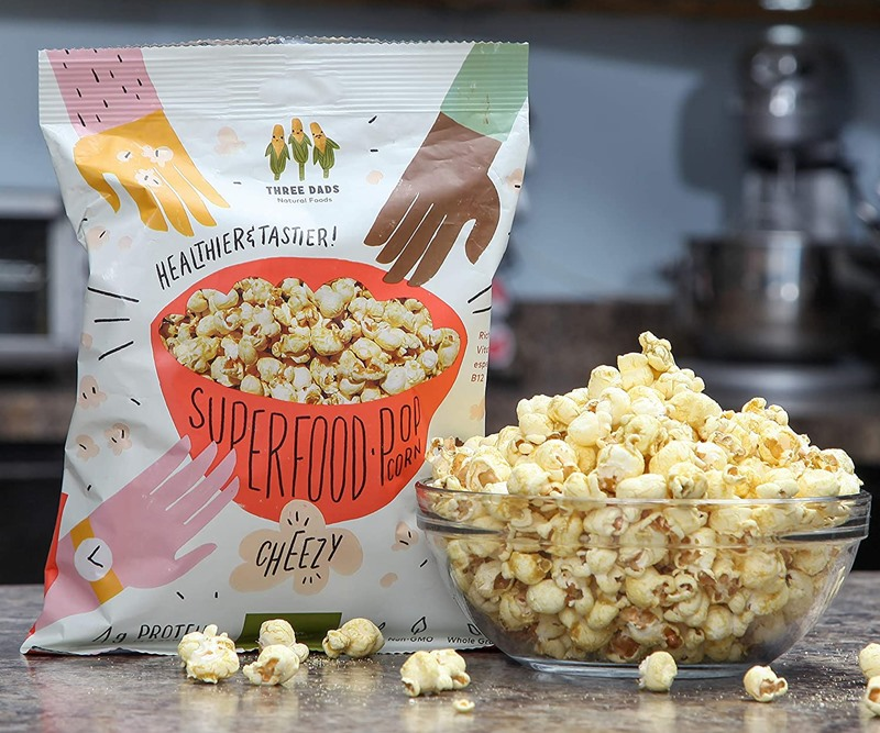 The Best Crunchy Cheesy Dairy-Free Snacks - from crackers to chips, puffs to popcorn, and more! Vegan, Gluten-Free, and Grain-Free Options. Pictured: Three Dads Superfood Popcorn