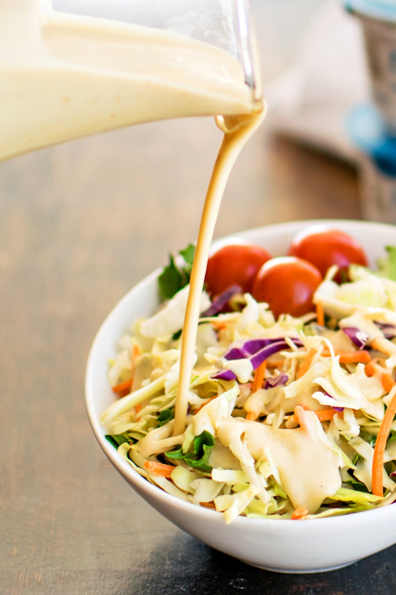 Dairy-Free Lemon Yogurt Salad Dressing Recipe - optionally vegan, paleo, and allergy-friendly. Light and creamy, great with fresh salads.